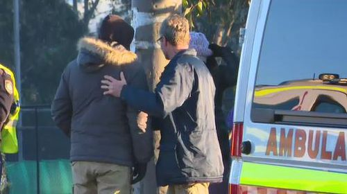 The make driver was comforted at the scene before being taken for mandatory testing. Image: 9News