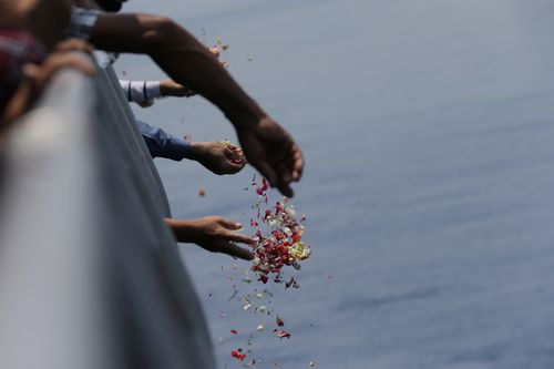 Tears flowed as flowers were thrown into the water in remembrance of the 189 lives lost on board Lion Air flight JT-610.
