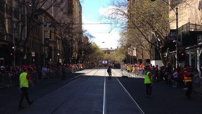 AFL fans started lining the streets hours before the parade was due to start. (9NEWS)