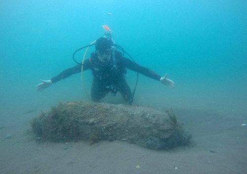 James Cunningham, 19, found a huge WW2 bomb while scuba diving under a Devon pier. (Facebook)