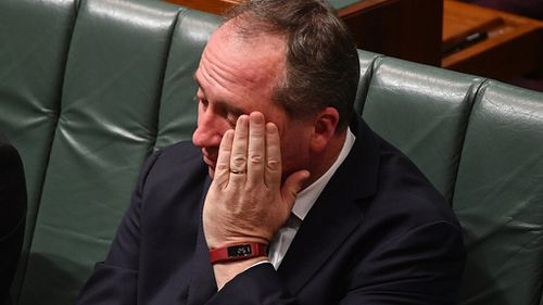 Joyce was seen with his head in his hands multiple times in parliament yesterday afternoon after making the announcement. (AAP)