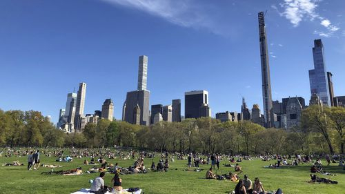People practice social distancing while enjoying the nice weather at Central Park's Sheep Meadow, Saturday, May 2, 2020,  in New York.
