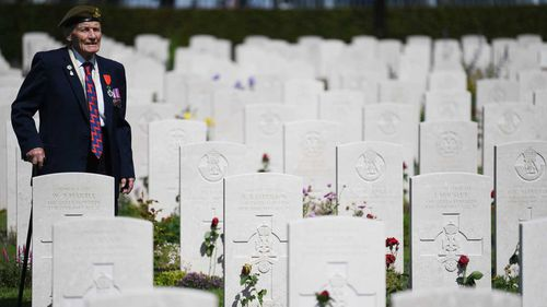 Normandy Veteran John Prior views graves ahead of the Royal British Legion Service of Remembrance at the Commonwealth War Graves Cemetery at Bayeux, France.