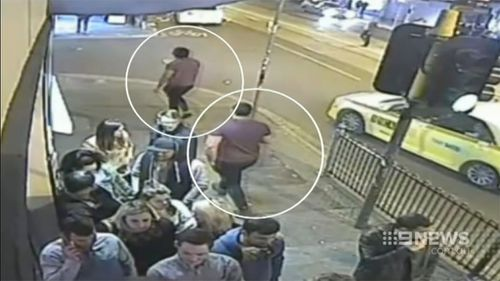 Police are hunting these two men in relation to the bashing. (9NEWS)
