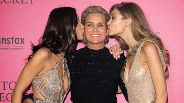 Bella and Gigi kiss their mother Yolanda Hadid at the Victoria's Secret show in Paris last year. Image: Getty