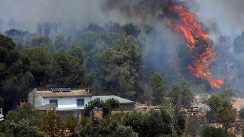 Dozens evacuated as huge fire tears through Spain amid heatwave
