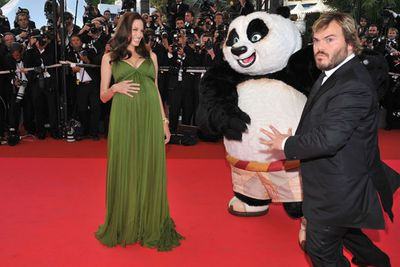 Pregnant with twins Knox and Vivienne, Ange laughed it up with Kung Fu Panda co-star Jack Black - and looked amazing in green Max Azria.