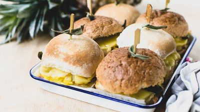 "Recipe: <a href=""http://kitchen.nine.com.au/2017/08/09/14/09/cheesy-ham-and-pineapple-tray-sliders"" target=""_top"">Cheesy ham and pineapple tray sliders</a>"