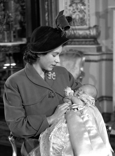 Princess Elizabeth holds Prince Charles at his christening, December 1948