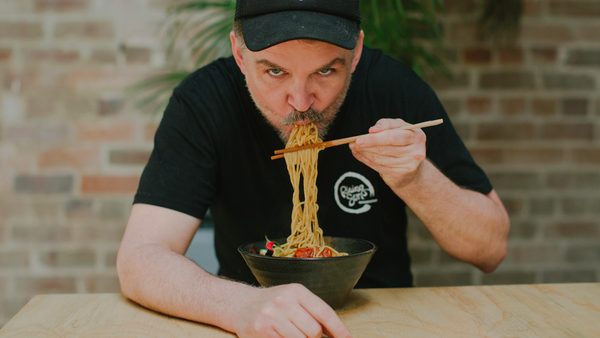 Rising Sun Workshop chef and owner Nick Smith tucking into some ramen