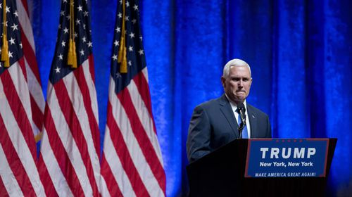 Pence steps behind the Trump podium in New York. (AAP)