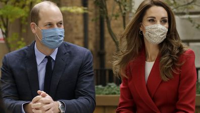 Prince William and his wife Kate the Duchess of Cambridge meet pharmacist Joyce Duah as they visit St. Bartholomew's Hospital in London, to mark the launch of the nationwide 'Hold Still' community photography project, Tuesday, Oct. 20, 2020