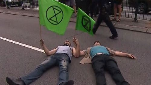 Extinction Rebellion Demonstrators Block Road Outside Downing Street