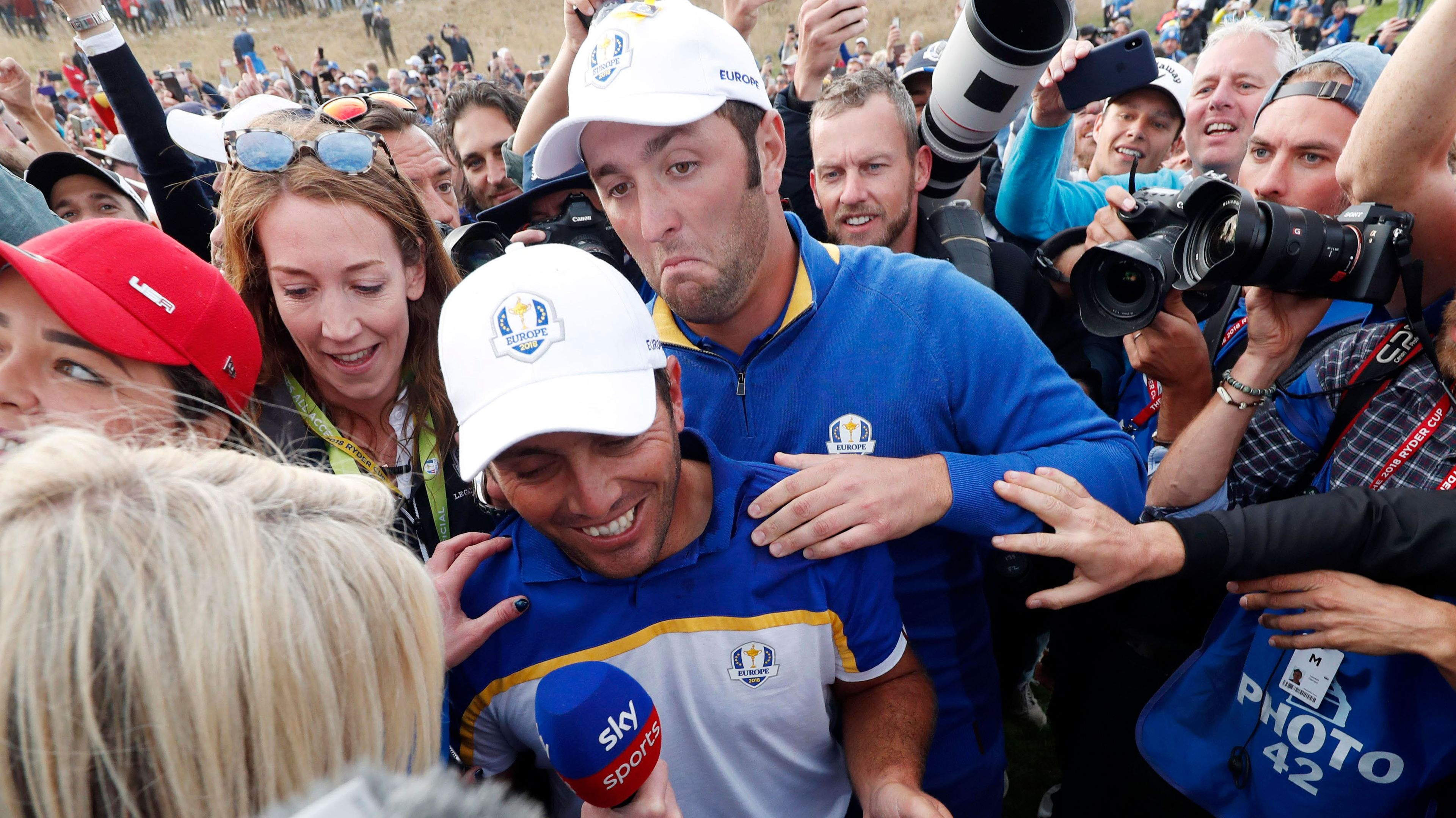 Francesco Molinari and John Rahm celebrate.