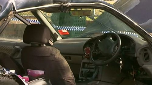 A man came to the couple's rescue and pulled them from the vehicle. (9NEWS)