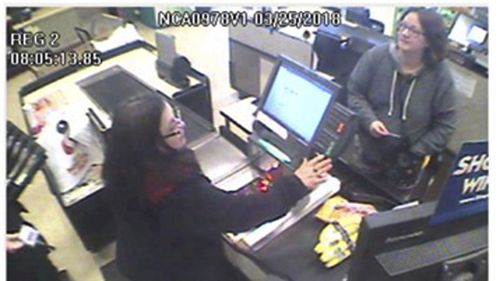 Safeway surveillance photo provided by the California Highway Patrol shows Jennifer Hart, right, at a Safeway store in Fort Bragg, California.