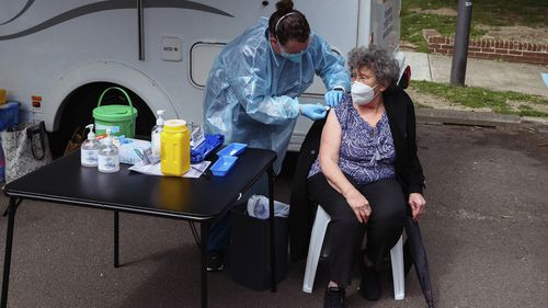 Raisa Myndra receives a Pfizer vaccine dose at a pop up vaccination hub at the Waterloo Public Housing Estate in Sydney.