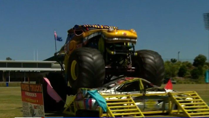 Harry Grant jumps a monster truck over a car.