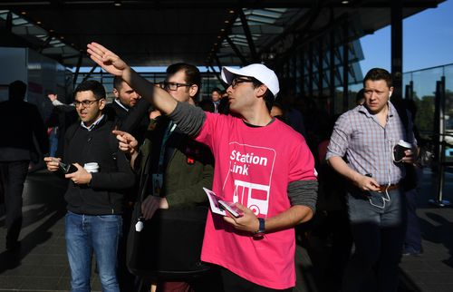 Staff in pink shirts directed frustrated commuters to 'Station Link' buses.