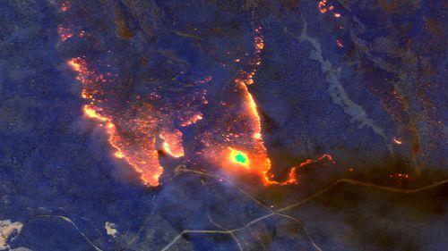 A satellite image shows wildfires burning east of Orbost.