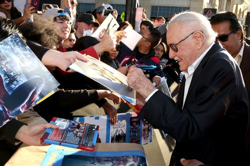 Stan Lee signs autographs as he arrives at the Los Angeles premiere of Captain America: Civil War in 2016. (AAP)