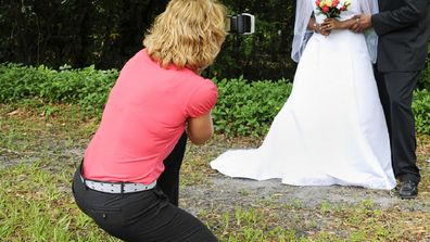 The wedding photographer made the mistake during the photo portion of the day.