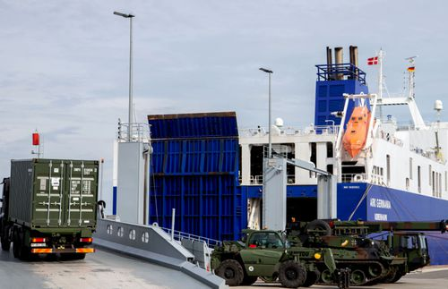 German military vehicles are loaded onto a ship in Emden, Germany, bound for the Trident Juncture exercises in Norway.