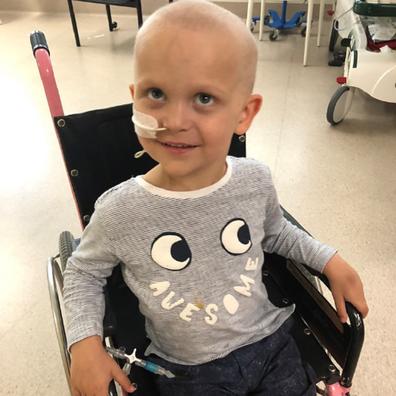 Ollie leukaemia sitting in a wheelchair