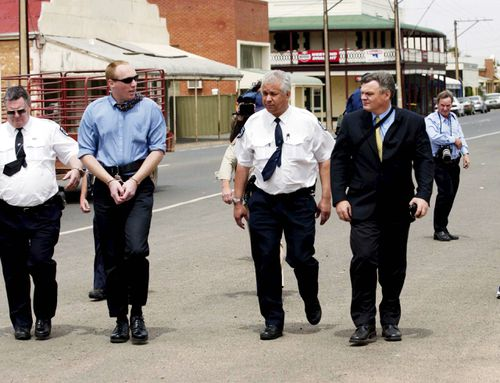 Convicted murderer Robert Joe Wagner (Handcuffed) is appealing a non-parole sentence and the victims are concerned if he ever gets out he will kill again.(AAP Image/Rob Hutchison)