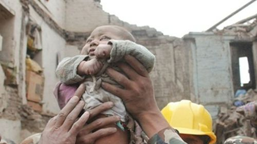 This four-month-old baby was rescued 22 hours after the quake first struck. (9NEWS)