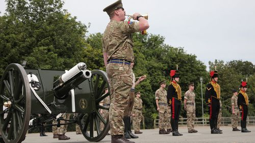 The Kings Troop Royal Horse Artillery carry out a socially distanced parade of 20 soldiers with their first world war Guns to commemorate the 75th anniversary of VE Day with a 2 minute silence in Woolwich on May 8, 2020 in London, England.