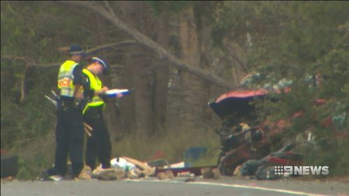 In Grafton, north of Coffs Harbour, another man was killed and five others injured in a two-car collision that saw a wife trapped in a vehicle for up to two hours.