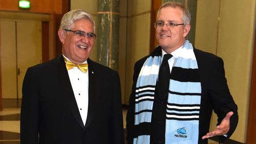 Liberal Member for Hasluck Ken Wyatt and then Treasurer Scott Morrison arrive for the annual Mid Winter Ball at Parliament House in Canberra in 2016.