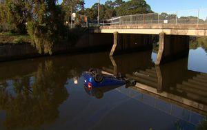 Men lucky to survive car crash into Sydney river