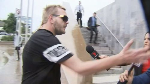 A supporter of Lewis clashed with media outside court. Picture: 9NEWS