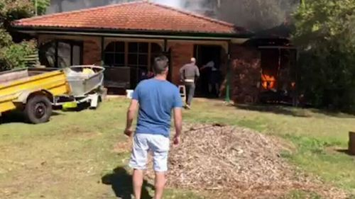 Neighbours help rescue the woman 'in nick of time' in Umina, NSW.