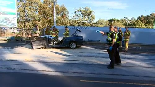A male driver is in a critical condition after his car collided with a tram. (9NEWS)