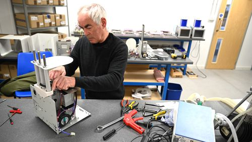 A man constructs a medical ventilator at the OES medical supply company in Witney, Britain. OES builds and supplies medical ventilators globally. They are altering their designs to make it more efficient and user-friendly to use in treating coronavirus.
