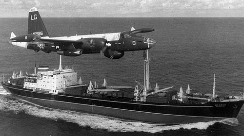 An American reconnaissance plane flies over a Russian ship bound for Cuba during the crisis. (Photo: AP).