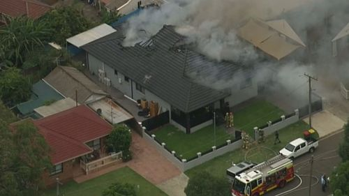 Emergency services were called to the house in Villawood about 3pm after reports of black smoke pouring from the building. (9NEWS)