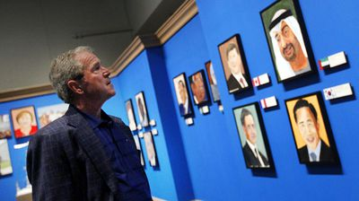 Former president George W Bush surveys his exhibition. (AAP)