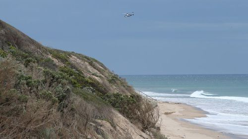 A police helicopter above the beach last Wednesday. (AAP)