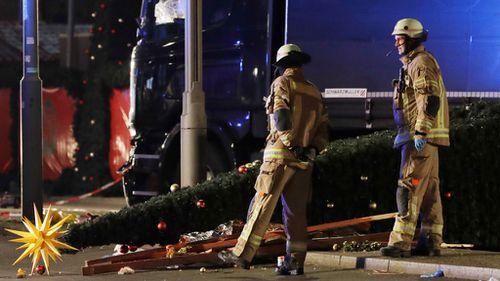 Emergency service workers near the scene of the Berlin Christmas market truck crash. (AAP)