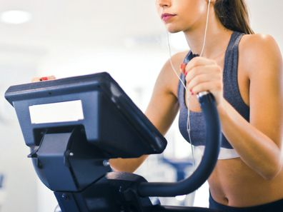 Woman on elliptical at the gym