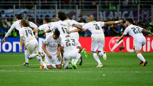 Real Madrid's players celebrate after winning. (AFP)
