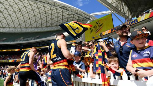 Thousands of Crows fans attended the 9.30am training session at Adelaide Oval. (AAP)