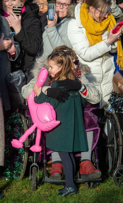 Gemma Clark from Lincolnshire hugs Princess Charlotte after the Christmas Day morning church service at St Mary Magdalene Church in Sandringham, Norfolk.