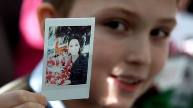 Luke Wheeler-Waddison, 10, takes a polaroid of Catherine, Duchess of Cambridge during a workshop run by the National Portrait Gallery's Hospital Programme at Evelina Children's Hospital on January 28, 2020 in London, England