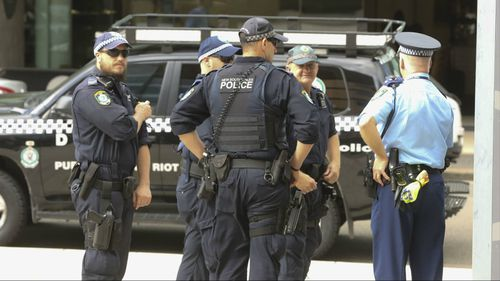 Armed police outside Paramatta District Court ahead of Alou's sentencing. (AAP)