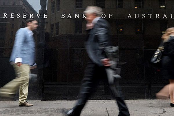 Pedestrians outside the Reserve Bank of Australia